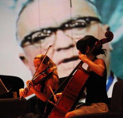 NWS Fellows perform at Lincoln Theatre with projected images - photo by Tomas Loewy